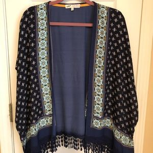 Fringed batwing cover. Size large.